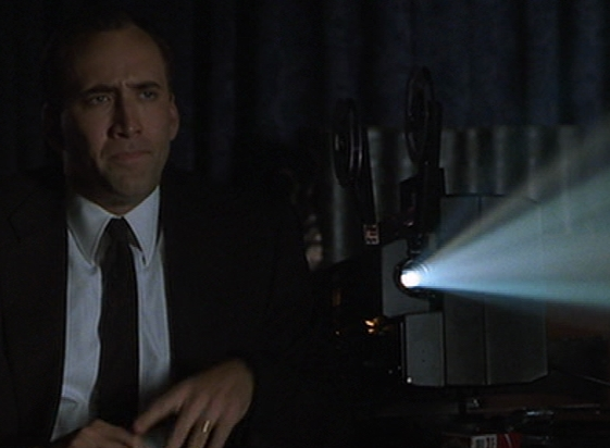 Nic Cage Watches a film in 8mm gauge