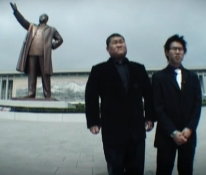 Simon and Jacob visit the statue of Kim Il Sung in Pyongyang